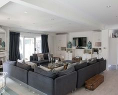 Living room interior with grey and brown furnishings at Coral Beach House, Luxury Beach House Rental, Angmering-On-Sea West Sussex