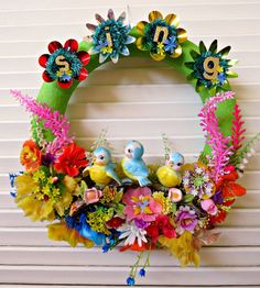 So sweet! Here is a fun Easter/Spring wreath made with vintage and new materials! This whimsical over-the-top wreath wrapped in pretty green