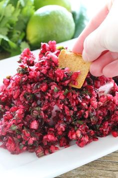 Fresh cranberries are minced up with jalapeno into a healthy, fresh, and vibrant salsa.