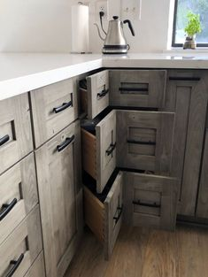 This fashionable #kitchen #remodel features Diamond's #gray semi-translucent #stain, #Thicket. The #Rustic #Alder #cabinets add to the #earthy feeling of the space, with a #nature-inspired look. #Matte #black #appliances, #faucet, #windows, and other fixtures complete the look. This kitchen was designed by #Lowe's Designer, Brian Galvin. Design your #dream kitchen and schedule your #free design appointment today! Kitchen Cabinet Remodel, Kitchen Cabinets, Alder Cabinets, Real Kitchen, Black Appliances, Cabinet Drawers, Nature Inspired, Matte Black, Earthy