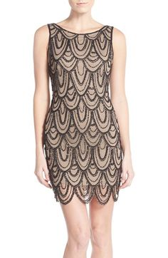 Pisarro Nights Embellished Mesh Cocktail Dress (Regular & Petite) at Nordstrom.com. Strands of gleaming beads and sequins create an Art Deco-inspired pattern atop the mesh overlay of a short evening dress with a rounded scalloped hemline.