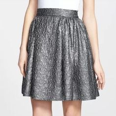 HOST PICK Kate Spade Gunmetal Aimee Skirt Kate Spade Aimee Skirt. Gunmetal. Fall/Winter 2013 collection. Size 8. Signature bow zip. Gorgeous for a formal occasion and the holidays! It's also very flattering -- it accentuates your waist :) Skirt the rules!  kate spade Skirts