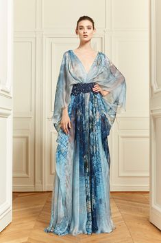 Houppelande from the Late Middle Ages, with its long length, fuller body, flaring sleeves, deep-v cut of the neckline, and empire waist detail reference the belt often worn Resort 2014 - Zuhair Murad