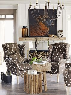 More Rustic, Art becomes center focal point.. wooden mantle and unique accessories lend a very different look