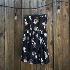 Strapless Party Dress Never worn, I really love it but have no where to wear it.                                                                Black & white rose pattern.                                               Stretchy band on the back. Forever 21 Dresses