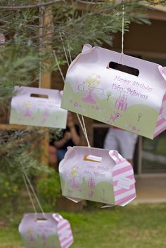 Fairy party favors hanging on a tree #outdoor #kids #party