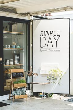 Simple Day | Signage on Internal Shutter, Styling Vignette, Trading Hours on Planter Box. #signage #tradinghours #blackboard #plant #open #cafe Deco Cafe, Retail Design, Door Signage, Shipping Container Store, Coffee Shop Design, Cafe Design, Store Design, Cafe Exterior, Restaurant Hotel