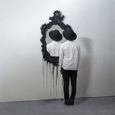 This photo is creepy in the best way. It is something so different that it makes you stop and stare for a moment. I love the black and white as well as the excess space around the man and mirror that give the image a clean appearance and simplify the image a bit. #artphotography
