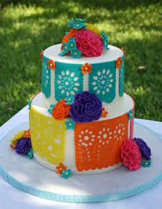 Fiesta themed birthday cake - Papel picado and flowers are gumpaste. Coconut cake with cream cheese filling.