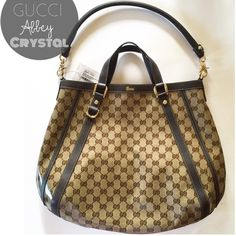"""Gucci Abbey Crystal Convertible Tote Crystal GG monogram coated canvas  Leather handle and trim Detachable shoulder strap Top snap button closure One interior large zipper pocket Original dust bag and tags included Made in Italy Measures approximately: 16"""" L x 13"""" H x 3"""" W - Strap drop: 8.5"""" Gucci Bags Totes"""