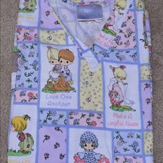 Precious Moments scrub top Beautiful precious moments scrub top! Great condition. Would go perfectly with the baby pink scrub pants I also have listed! Buy both & receive 10% off! Tops