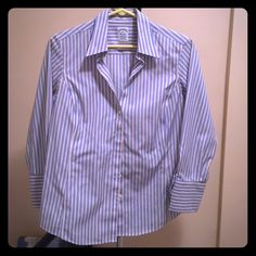 Women's Brooks  Brother dress shirt Light blue stripes with thin hints of yellow stripe. Crisp look for a great price! I love the way this shirt fits. Size 10 petite fitted. Brooks Brothers Tops Button Down Shirts