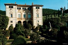 Guests at Villa Cetinale are welcomed by a formal courtyard of clipped box hedges, topiaries, and lemon trees. Standing sentinel are Giuseppe