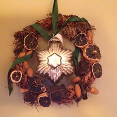 My favourite wreath with dried orange, lemon, pine ones and cinnamon