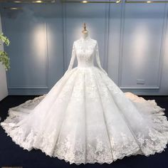 Luxury Muslim Modest Long Sleeve Lace Ball Gown Wedding Dress with Long Train #21011215 If you have any questions,please email us: dollygown@hotmail.com IMPORTANT NOTE: If you want to pay by credit card,Please choose PayPal.Paypal accept payments from any kind of Credit Cards. The Muslim Modest Ball Gown Wedding Dress is fully lined, 4 bones in the bodice, chest pad in the bust, lace up back or zipper back are all available, total 126 colors are available. When ordering our store allow you to ad Muslim Wedding Gown, Ballroom Wedding Dresses, Wedding Dress Organza, Lace Wedding Dress With Sleeves, Lace Ball Gowns, Princess Wedding Dresses, Perfect Wedding Dress, Dream Wedding Dresses, Ball Dresses