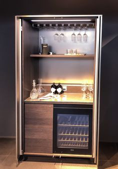 This pocket door system is available in +Stage range by Poggenpohl Home Cocktail Bar, Modern Home Bar, Gin Bar, Pocket Doors, Bar Furniture, Cupboard, Liquor Cabinet, Interior Design, Kitchens