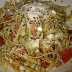 Chicken, pesto, artichokes, tomatoes, and parm! Yum!