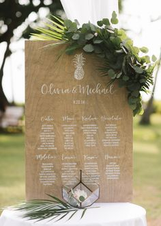 This wooden seating chart features tables named after Hawaiian islands (perfect for the couple's island celebration) and an adorable pineapple illustration. Now that's what we call a finishing touch.