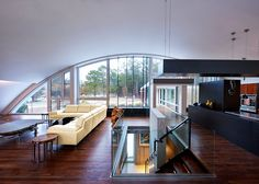 MB Architecture's Stunning Energy-efficient Green Arc House is Mostly Buried Underground Architect Maziar Behrooz, energy efficient, Green Arc House, airplanes hangars inspiration, East Hampton Arch House, Dome House, House Wall, Contemporary Kitchen Design, Modern House Design, Home Interior, Interior Architecture, Sustainable Architecture, White Sofa Design