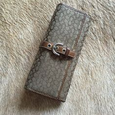 Coach glasses case Soft fabric glasses case lined in leather in classic Coach logo print. Some staining on the inside but the outside is in perfect condition! Can be used for sunglasses or eyeglasses. Snaps closed Coach Bags