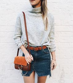 distressed jean skirt   light gray turtlenecks   small leather satchels / bags   belted   casual going out   fall