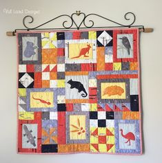 This cute wall hanging measures 78cm square (30½in square). On the Edge of Town conjures up ideas of a little country locality, with the bush on the edge of town, kangaroos hopping down the street, a kookaburra in the old gum tree and a platypus in the stream.   Val Laird Designs