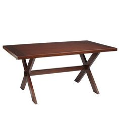 """Nolan Extending Trestle Table - Tuscan Brown. """"Drop in Nolan's two breadboard leaves, each measuring 16 inches, and you can accommodate 10 or more along the 96-inch plank top. Crafted of hardwoods, and defined by rustic details including X-shaped supports, a Tuscan stain and warm lacquered finish."""" Without leaves: 64""""W x 38""""D x 30""""H; with leaves: 96""""W. (reg 599.95, sale 549.99)"""