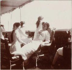 "Empress Alexandra Feodorovna of Russia with three of her daughters,Grand Duchesses Anastasia, Olga and Maria Nikolaevna Romanova of Russia. ""AL"""