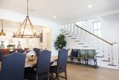 Foyer Dining Room Open Concept. Foyer opens to dining room. How to decorate open concept foyer to dining room. Foyer Dining Room Transition. #Foyer #DiningRoom Graystone Custom Builders.