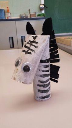 Zebra preschool craft from paper towel roll.