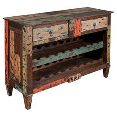 "Bring a chic finishing touch to your home decor with this eye-catching design, perfect for displaying a lush floral arrangement or your favorite family photos.  Product: CabinetConstruction Material: WoodColor: Distressed brownFeatures:  Can store up to 18 bottlesTwo drawers Dimensions: 30.5"" H x 43"" W x 14"" D"