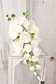 A luxury tear drop shower wedding bouquet made from cream colour fast foam Roses and Ivy. There are also diamante flowers.   These are stunning and ideal for weddings abroad and displays. Buy online at www.discountfloralsundries.com