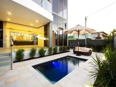 In-ground pool design using brick with pool fence & decorative lighting - Pool photo 210960