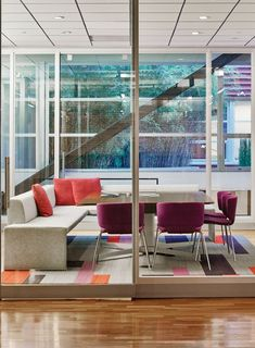 Coalesse Together Bench and Wrapp Chair create a modern conference room for collaboration.