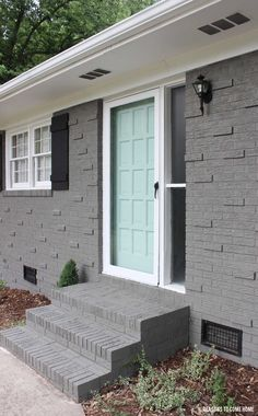 "Sherwin-Williams ""Gauntlet Gray"" (brick), ""Waterscape"" (door)"