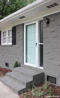 """Sherwin-Williams """"Gauntlet Gray"""" (brick), """"Waterscape"""" (door)"""