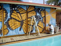 Butterfly mural painted on sun screen fabric for shade