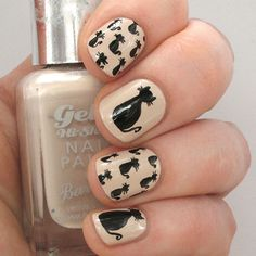 This manicure is absolutely purrrfect for a cat lover. Choose any base color--we like how classy this nude polish looks against the black--and then paint the bodies of each cat, making an upside down tear drop. Add a small circle for the heads and two small triangles for the ears. Lastly, draw cane-shaped lines for the tails. (Click for the full black cat nail art tutorial)