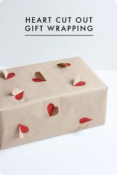Heart Cut Out DIY Gift Wrap. Valentine's Day or whenever! Better if you can find reversible paper that way the heart is all red on the inside. | best stuff