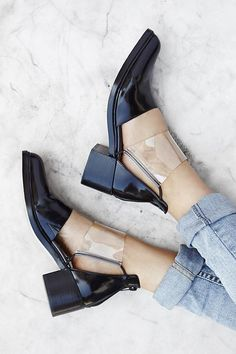 Black short boots. Leather shoes with transparent plastic. Fashionable. Fashion trends. Must have.