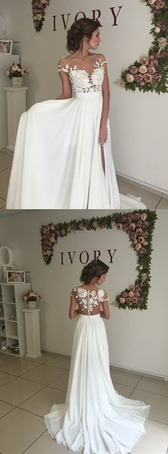 "Gorgeous! Love the flower appliqué over the sheer. ""2016 wedding dress, long wedding dress, white wedding dress, wedding dress with side slit, cap sleeves wedding dress #wedding #white"""