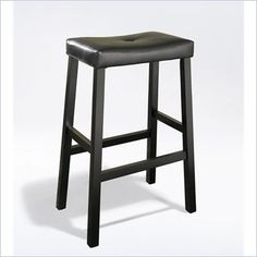 "Crosley Furniture Bar Height Upholstered Saddle Seat Bar Stool in Black Finish - Comfort and Style combined. The Upholstered Saddle Seat Stool features solid hardwood construction. The cushioned saddle seat is upholstered in faux leather PVC, that is stain and spill resistant. The 29"" height make this stool perfect for a 36"" height dining table or counter seating."