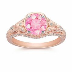 Seventy round, pavé-set diamonds, at approximately .30 carat total weight, provide the perfect accent in this equisitely detailed quality 14 karat rose gold ring. Shown with a center stone Round Pink Sapphire.