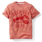 He'll dive into play in this bright short-sleeve tee. Oversized graphics give it a boyish look.