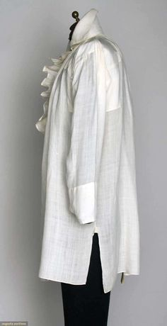 "MAN'S FINE LINEN SHIRT, 1790-1810  Lot: 181 November 13, 2013 - NYC New York City White linen, CF ruffled opening, high stand collar, L 35"", (few small holes in back) very good.  Price Realized: $ 1800.00 Category: Gents Era: 1800-1850 29.13410.100.181"