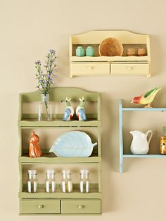 Rack of Art  Typically used to display collectibles, these shelves are now the collectibles themselves. Watch for small spice racks and shelves at resale shops and yard sales. Paint them in a variety of soft cottage colors and hang them on the wall.