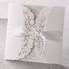 12 Laser cut flora & lace wedding invitations with ribbons Bhands http://www.amazon.co.uk/dp/B00KLM68C6/ref=cm_sw_r_pi_dp_6aTTub1GZ646T