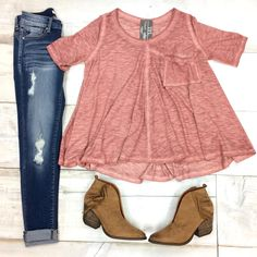 """Oversized, slouchy pocket top with short sleeves and a mineral wash distressed look. Hi-lo hemline. Very loose and flowy fit. Rose/mauve in color. Available in plus sizes. Model is 5'8"""" pant size 2 wearing size small. Fits oversized but intended to. S(0-4) M(6-8) L(10-12) XL(14) 1XL(16) 2XL(18) 60% Cotton, 40% Polyester."""