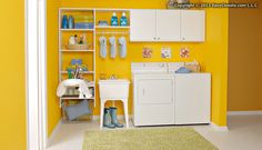 An organized laundry room with a fold-out ironing board and pull-out baskets! From EasyClosets.com