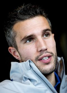 Robin van Persie. He looks good even with grey hair!! ^^